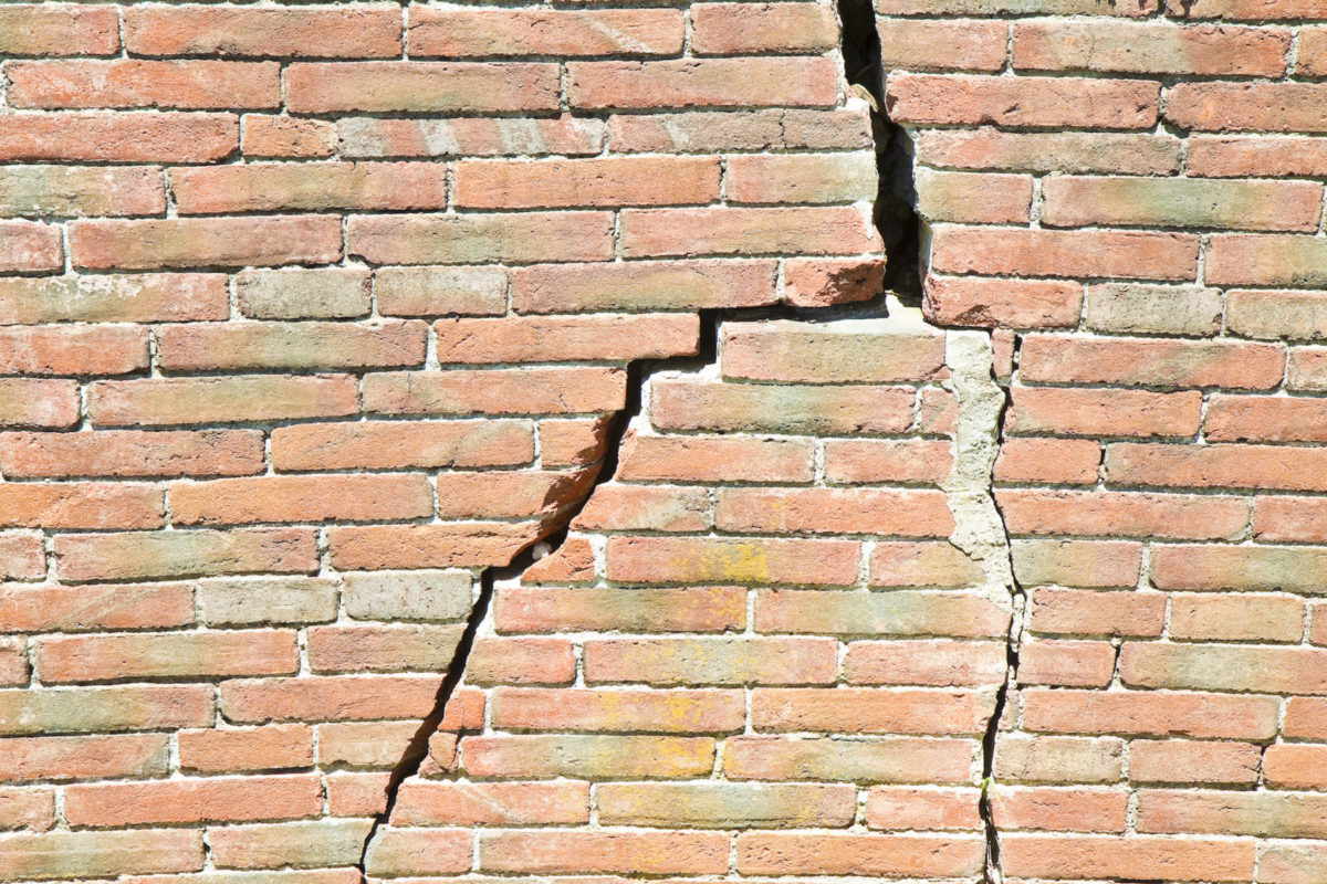 Dilapidation cracked broken wall